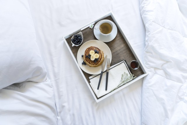 Pancake Breakfast in Bed on white sheets