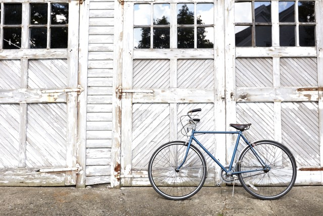 Bicycle in front of barn