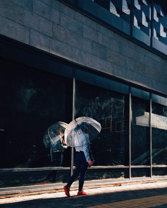 Woman with umbrella walking on the street