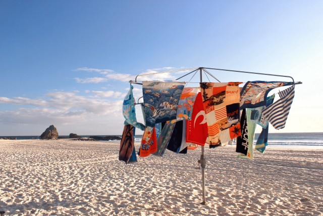 💲✔️  Towels on a clothesline at the beach, eco friendly, avoid using a dryer, conceptual