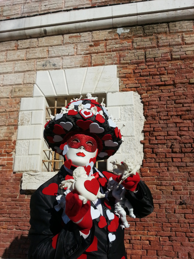 Venice Carnival ... Best carnival in the world, when poetry and mystery meets city life... person wearing a mask outdoors  , artisanal work