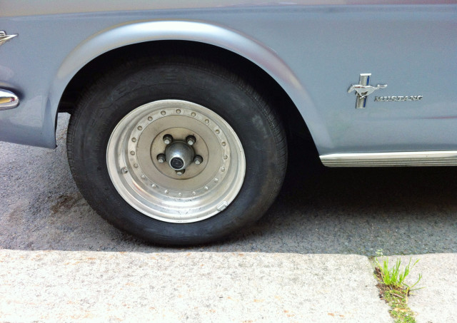 Great and cool design of that blue grey loved Mustang, parked car, sunny, wheel, closeup, copy space