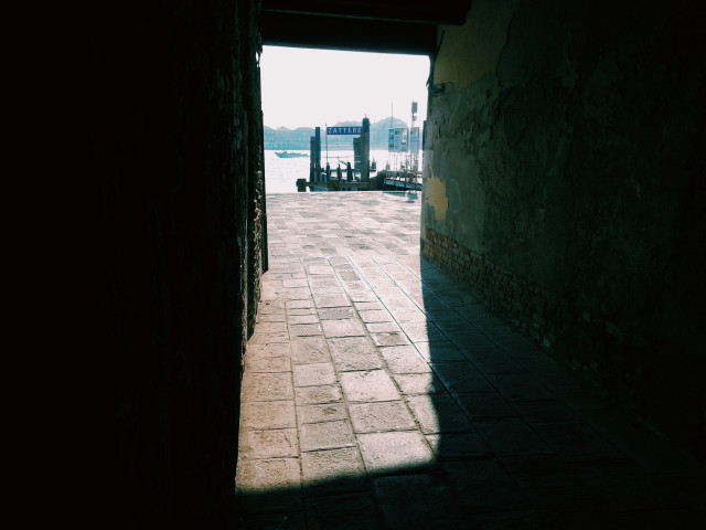 Secret Venice, Italy, from a narrow street to a pier facing a canal, light and shadows, cityscape, city view, sunlight, walls, perspective, zattere, city life, copy space