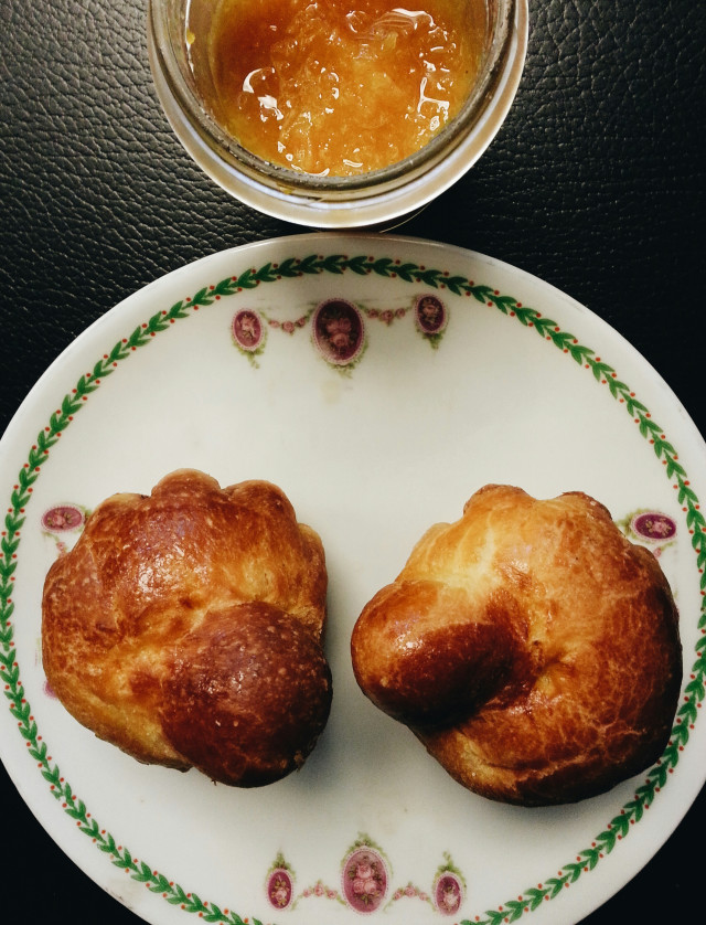 Morning : these two can talk the time they want, but they're gonna be eaten soon with that delicious marmalade... brioche, porcelain plate, from above, flat lay, breakfast, dessert, natural light, closeup, copy space