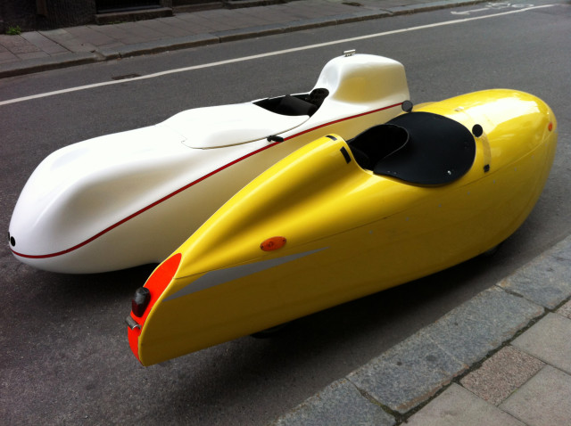 Futuristic mode of transportation. New way to drive in the city. Modern technology . Aerodynamic vehicle, white and yellow, in the street. Welcome in the 22nd century ! Outdoors, natural light, copy space