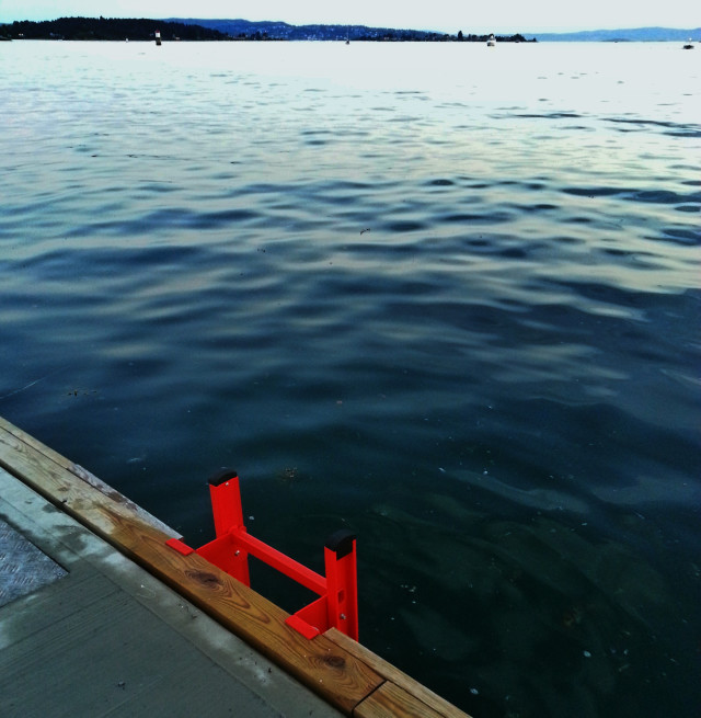 Summertime : after or before a jump ! Blue sea and red ladder , horizon over the sea, wet floor, sunlight, leisure, seaside, reflections on the water, ocean, copy space