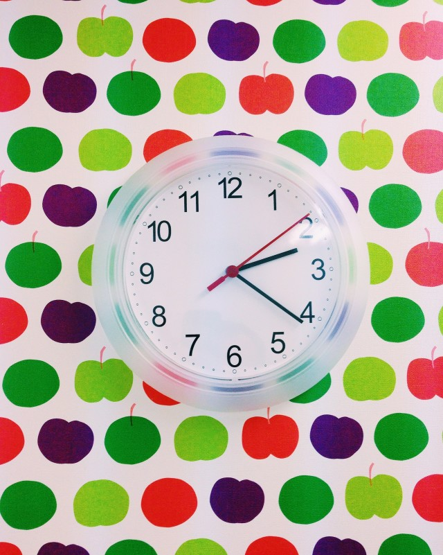 Fruity wallpaper behind a clock on the wall of a classroom in a private English school in Yokohama, Japan.