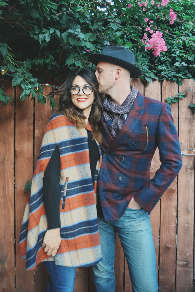 Trendy couple in plaid, jeans and hats