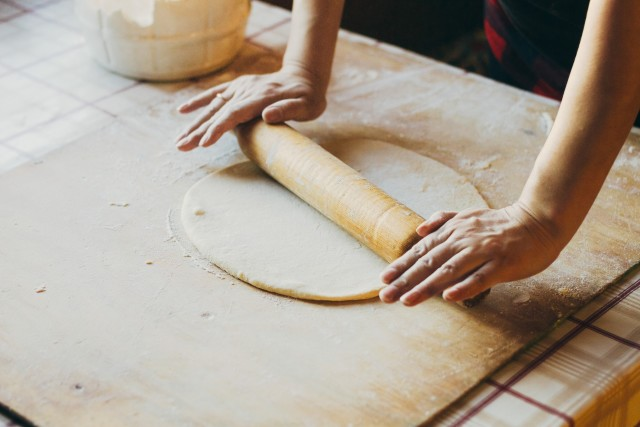 Rolling the dough with a rolling pin