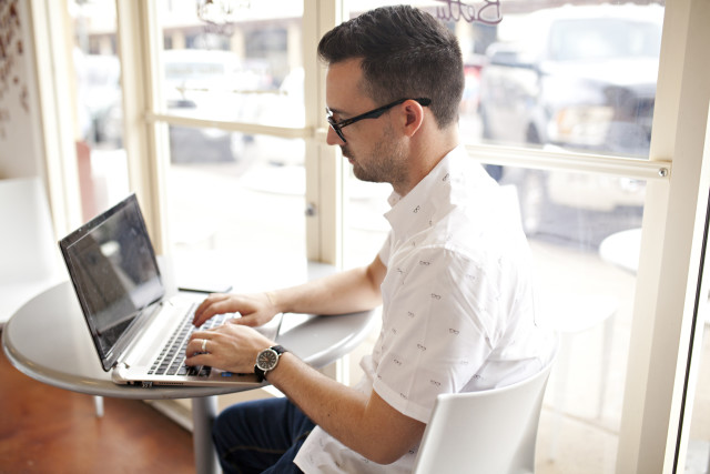 man on laptop and computer in a restaurant, computers, working from home, home office, business man, working desk, using technology, people using laptop, people using computers, people using technology, laptop computer, business, office, professional, business person, business people, business professional, business professionals