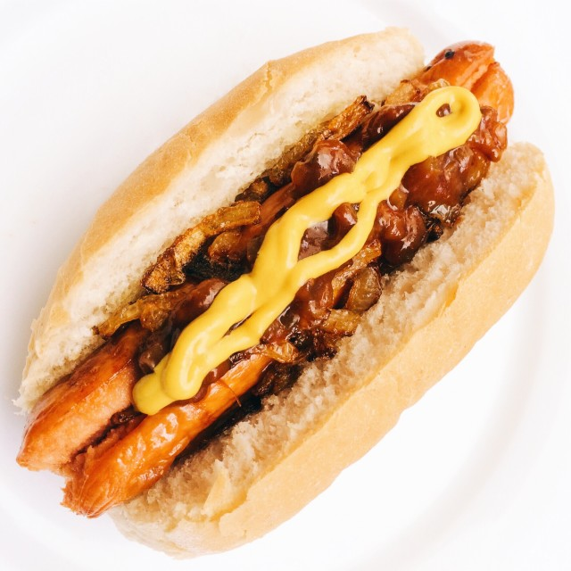 Hotdog with fried onions and mustard