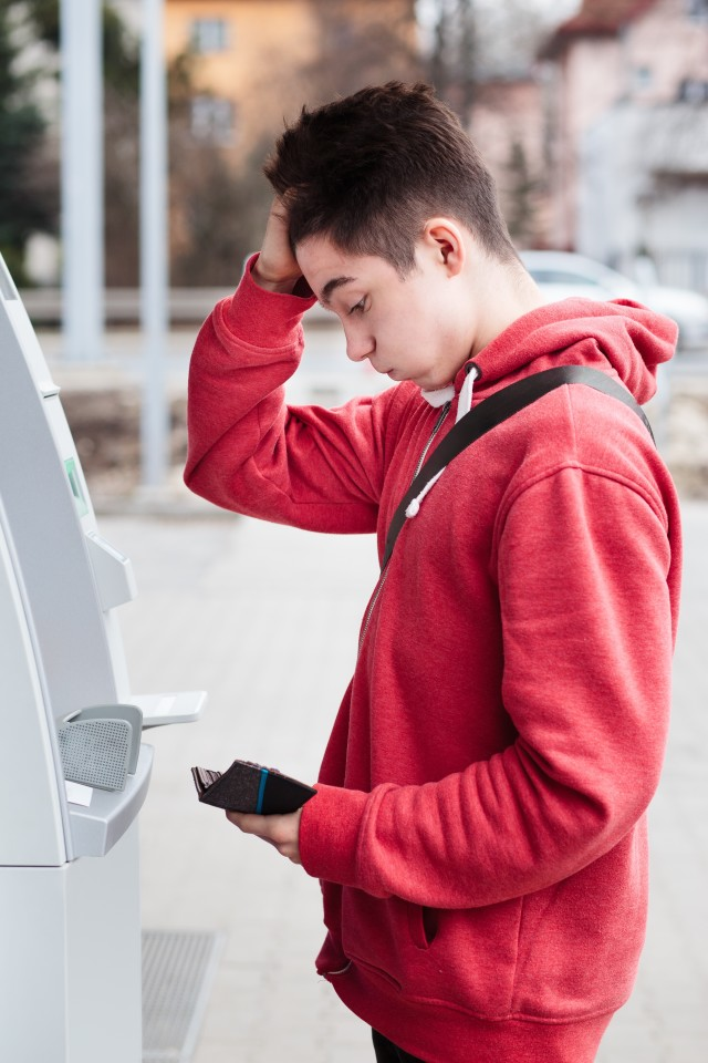 Man found he lost his debit card. Withdrawing money from ATM. Lost money. Surprised man. Lost card