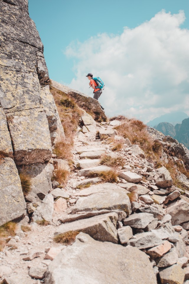 Hiking in mountains. Summer vacation trip. Man going up. Travel time. Active time outdoors. Hike in the Tatra Mountains