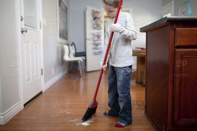 A Clean Sweep : boy sweeping the kitchen with a broom stock photo 638d46a8 5712 4557 94a7 12dc796cf400 ~ Hamham.info Haus und Dekorationen