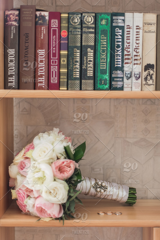 A Shelf With Books And Bouquet Wedding Rings Stock Photo 6b00e1d8