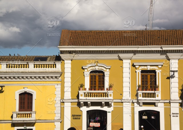 Yellow Colorful Colonial Buildings In San Francisco Plaza In Old Quito