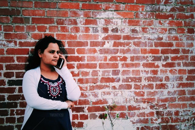 stock photo, people, brick-wall, young-woman, information, woman, mom, informative, single-parent, bad-news, brickwall, call, news, call-me, business-woman, momme, real-woman, using-phone, using-mobile, talking-on-phone