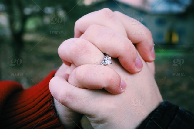 Hands Holding An Engagement Ring