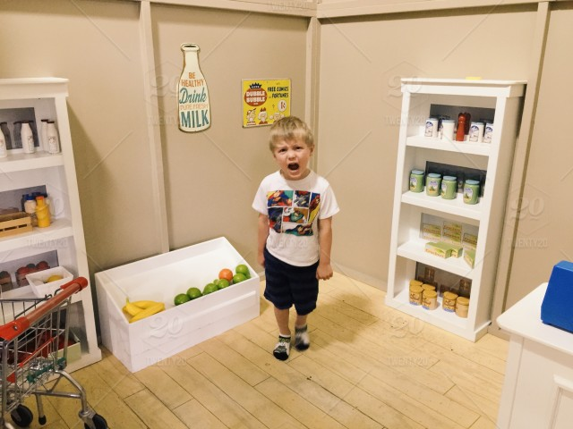 Little boy outraged and angry at the play kitchen / store\'s lack ...