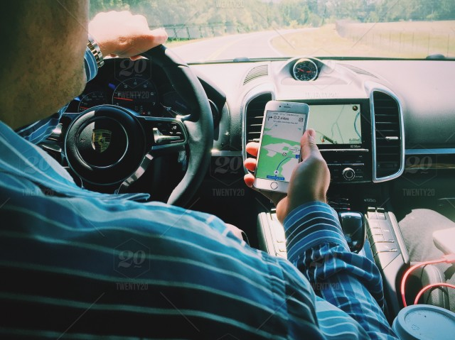 Using mobile phone and GPS while driving stock photo 898ca793 ... on