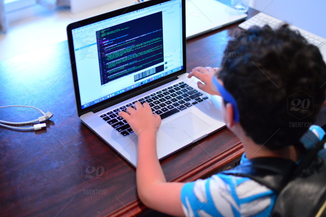 kid programming writing codes on the computer stock photo a828b767