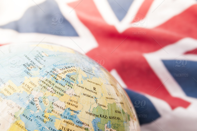 Map Of Uk On Globe.Earth Globe Map Of Europe And British Flag In Background Illustration