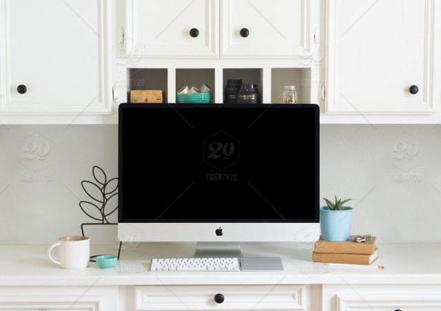 Styled white desk with iMac stock photo 9e08a3f1167f408cab4d