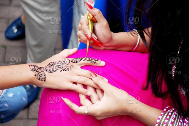Indian Artist Draws A Temporary Henna Pattern On Girl S Hand Stock