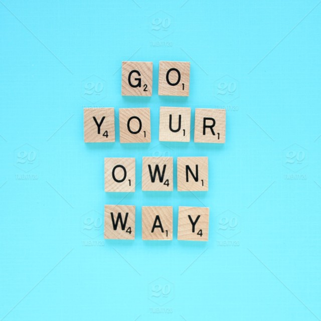 Go Your Own Way A Scrabble Tile Quote Against A Turquoise Blue