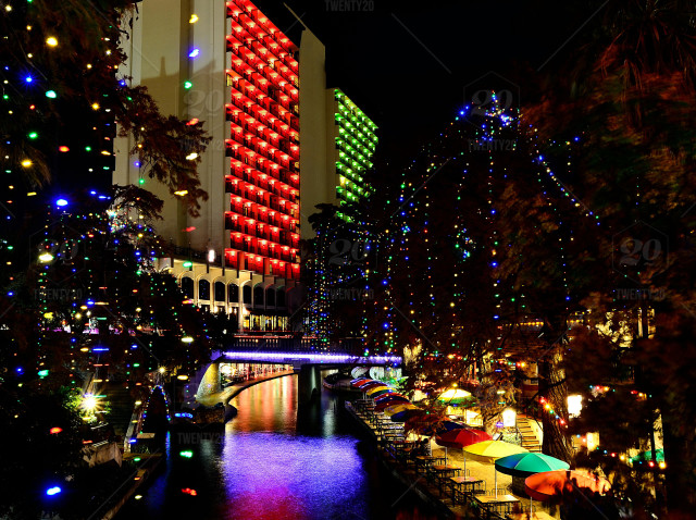 nothing beats the christmas lights on san antonios riverwalk during the holiday season with the hilton palacio del rio hotel dressed in its annual red