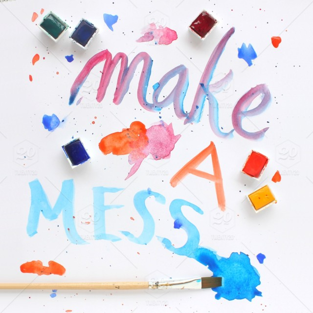 Make a mess! A messy watercolor desk with brushes  stock