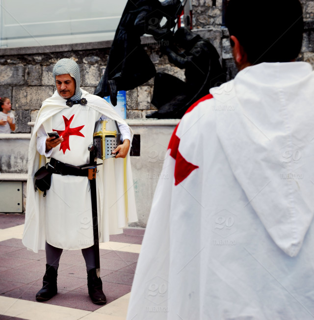 Knight templar using his mobile device - during the