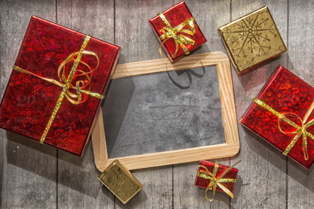 Red And Gold Gift Boxes With Over Wooden Background With