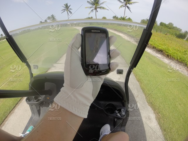 Using A Golf GPS Handheld Device Range Finder   x stock