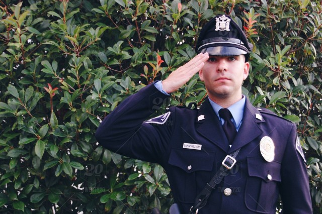 stock photo, business, working, formal, cop, business-person, police-officer, policeman, young-professional, formal-wear, man-in-uniform, in-uniform