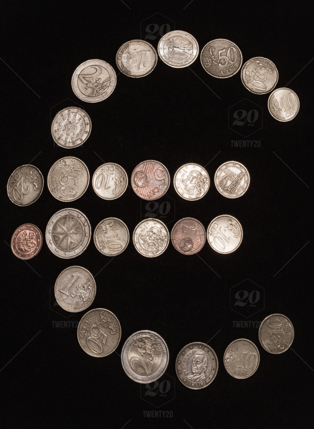 Symbol Of Euro In Coins Stock Photo 18c78ca4 Ea71 4dc5 B8c0 8970cce958df