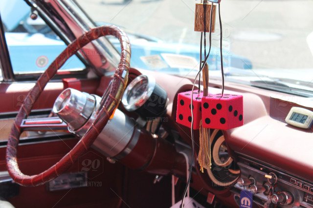 Red Interior of a vintage car with red fuzzy dice stock photo