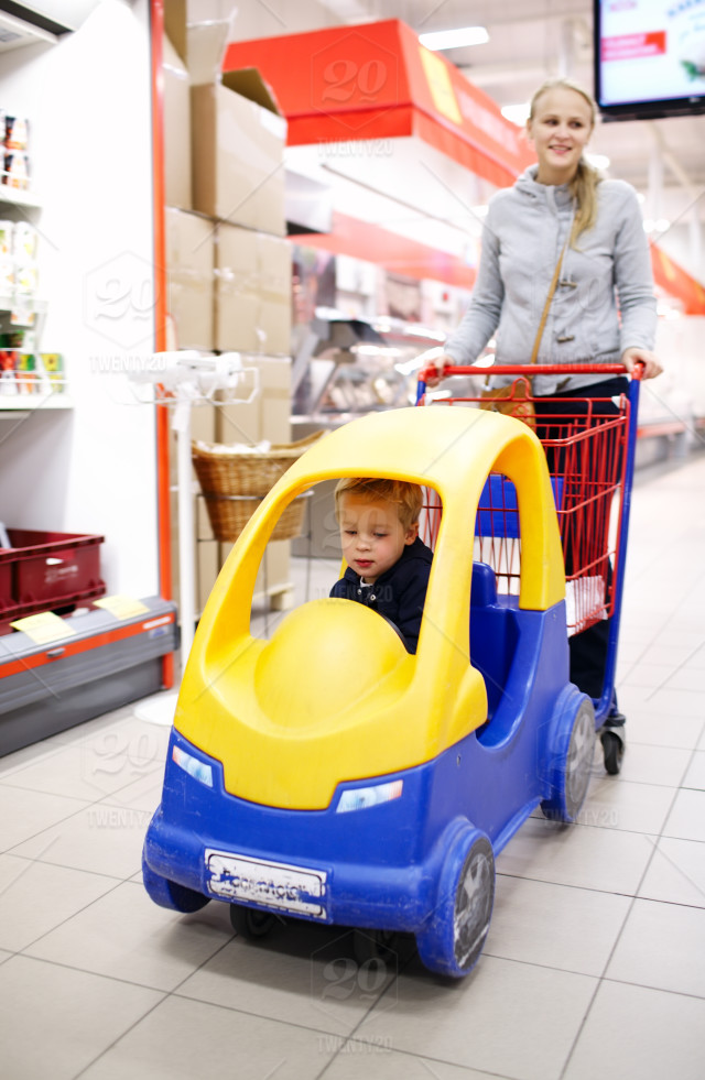 Child friendly supermarket shopping with a young mother