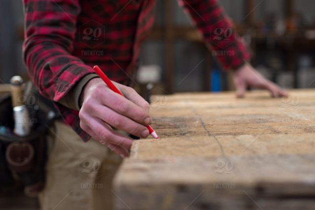 8ae2dad5c7f9 Detail of mans hands marking a piece of wood. stock photo e047fa4e ...
