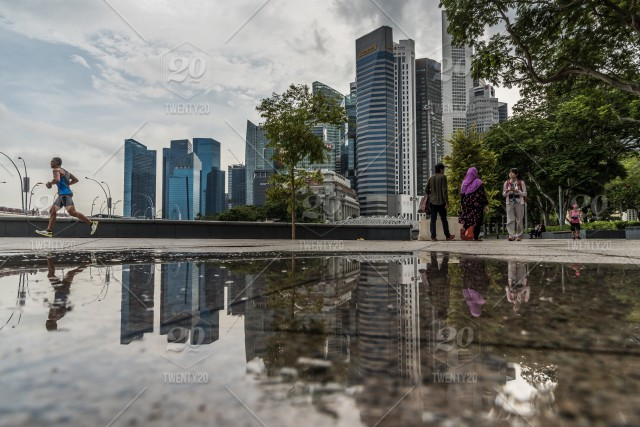Reflection Of Singapore S Downtown Skyscrapers At Esplanade Park