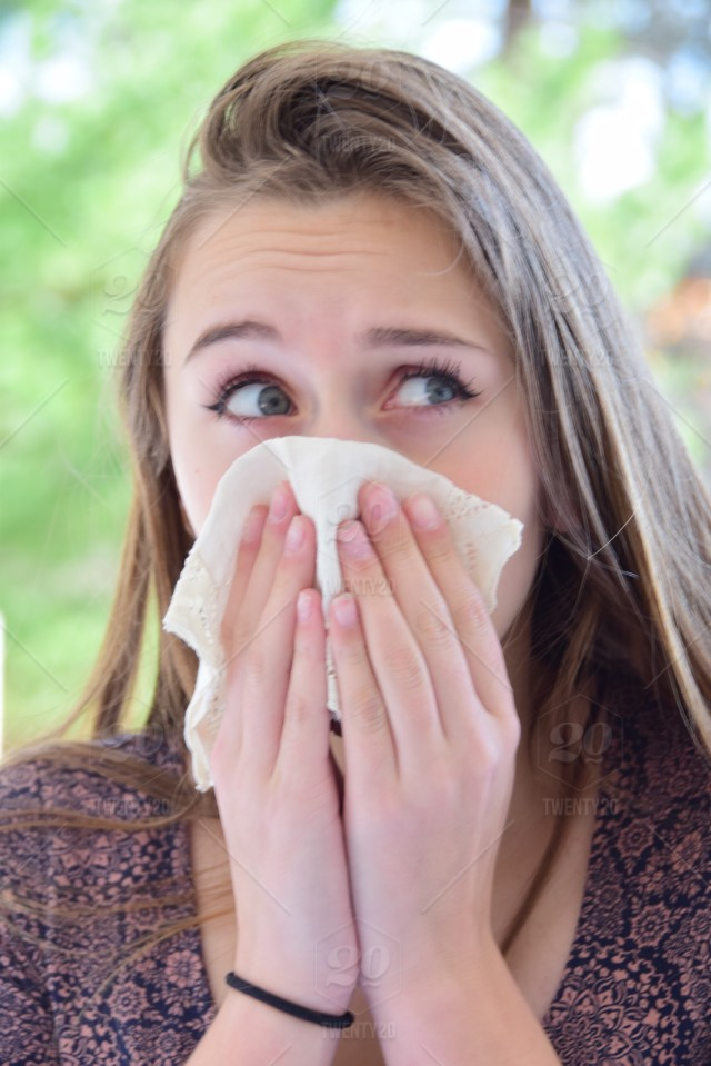 stock photo, young-woman, sneeze, pretty-eyes, allergies, allergy-season, seasonal-allergies