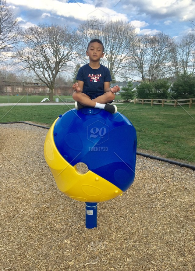 This is how my son meditates  Zen at a playground! stock