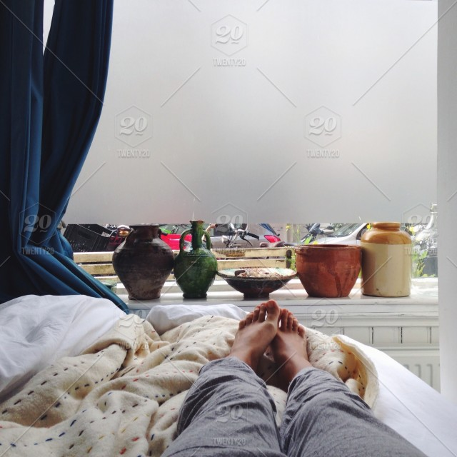 Relaxing At The Morning In The Bed Feet View Stock Photo 1b39801b 2d05 4d6b B2d8 A232c867f3d9