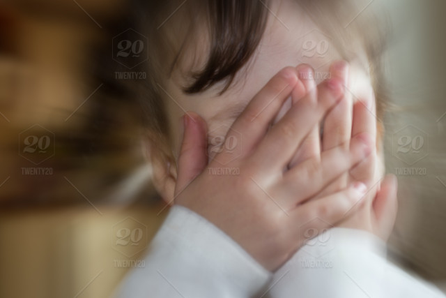 Blurred Portrait Of Sad Crying Little Girl Covering His Face With Hands