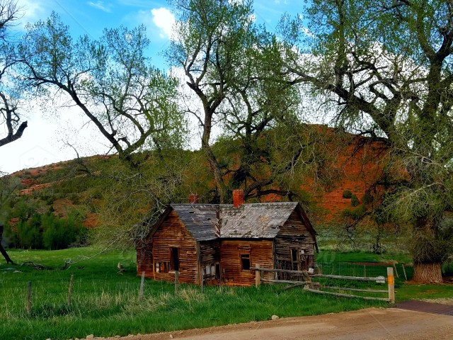 Old cabin in red canyon stock photo 76b701ff-c379-4d73-aaf2