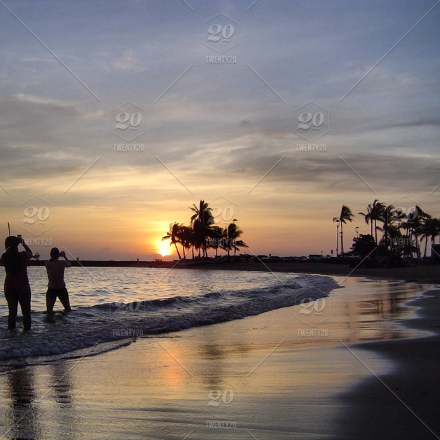 Sunset In Waikiki Beach Honolulu Hi 96815 Stock Photo