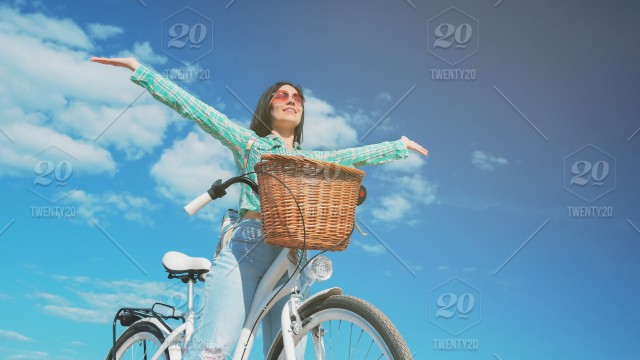 Beautiful Young Lady With White Retro Styled Bicycle Hands Up