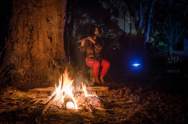Camping In The Woods With A Fire Wood Clarinet Musician