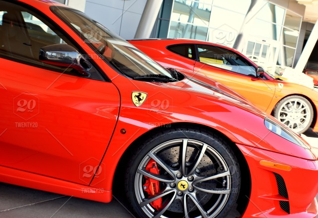 Red Ferrari With Yellow Prancing Horse Badge At High End Car