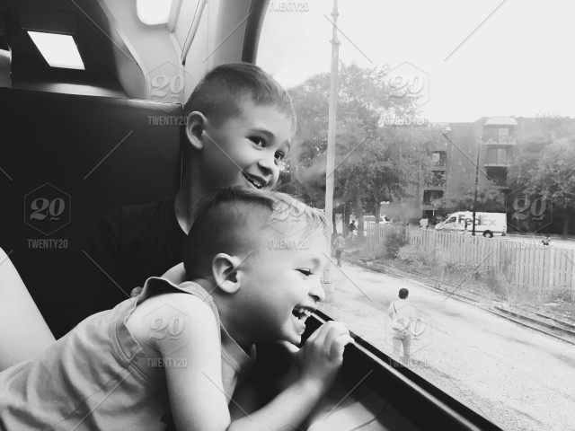 Black And White Photo Of Two Laughing Brothers Looking Out A Train Window Stock Photo Fa1a80e8 0a5a 43cb 84a4 61c52479b49d